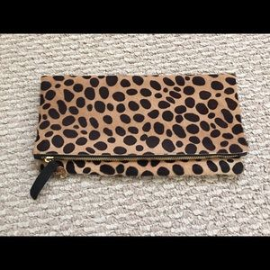 Clare V. Leopard fold over clutch.